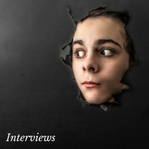 A face breaking through a wall.