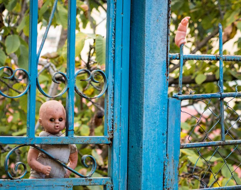 One of the many dolls decorating residential exteriors in Saranda, Albania as protection against the evil eye. Photo by Kevin Urbanski.