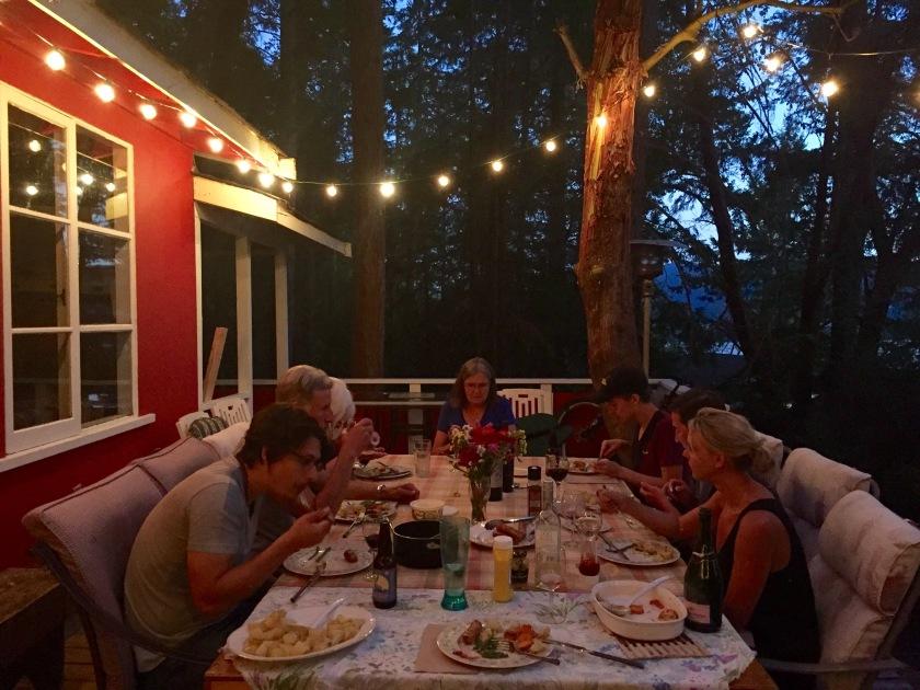Amanda's family having dinner outside.