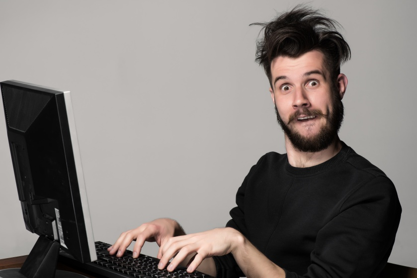 Funny and crazy man using a computer By master1305