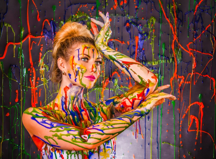 Beautiful young woman covered with paints By art_zzz